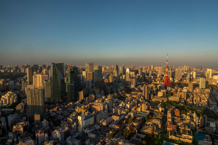 Tokyo skyline at golden hour Japan Tokyo Travel Architecture Building Building Exterior Built Structure City City Life Cityscape Clear Sky Golden Hour Landscape Modern No People Office Building Exterior Outdoors Residential District Sky Skyscraper Smog Tall - High Tower Travel Destinations Urban Skyline