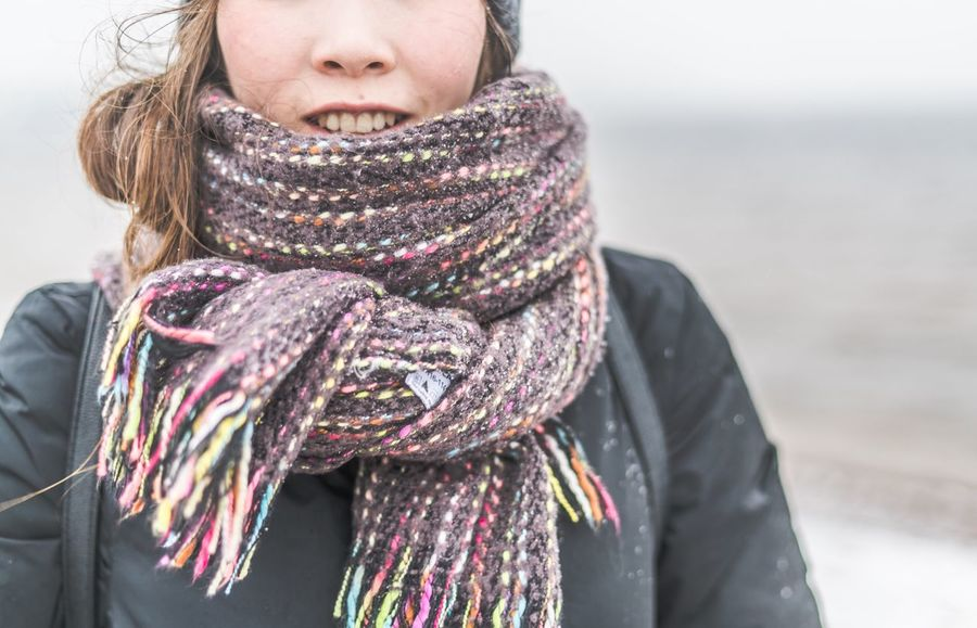 EyeEm Selects One Person Scarf Winter Clothing Warm Clothing Front View Leisure Activity Focus On Foreground Real People Females Women Lifestyles Cold Temperature Waist Up Young Adult Casual Clothing Day Standing Outdoors