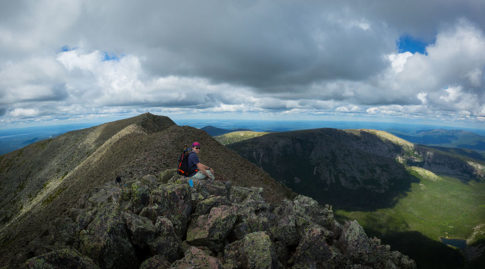 Man sitting on rocks at mount katahdin