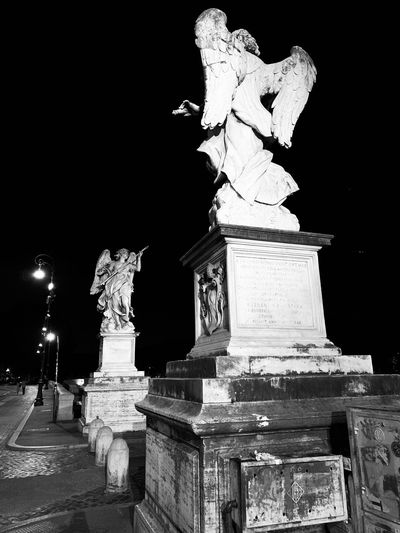 Statue of historical building at night
