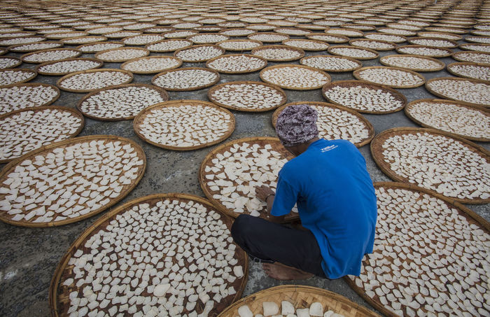 A man on Drying process of Fish Crackers at Indramayu West Java Indonesia Fish Crackers West Java  West Java,Indonesia Crackers Factory Drying Process Factory Indoors  Indramayu One Person