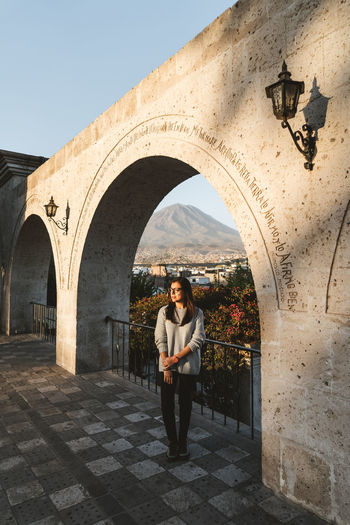 Lonely woman enjoying the last rays of sun in Arequipa, Peru. Can you spot the Misti volcano in the background? Arequipa Peru Travel Travel Photography Adult Arch Architecture Brunette Casual Clothing Full Length Girl With Glasses History Lifestyles Lonely Girl One Person Peruvian Real People Southamerica Standing Sun Beams Sunset Travel Destination Volcano Yanahuara Young Women #urbanana: The Urban Playground A New Beginning 50 Ways Of Seeing: Gratitude Capture Tomorrow My Best Photo International Women's Day 2019