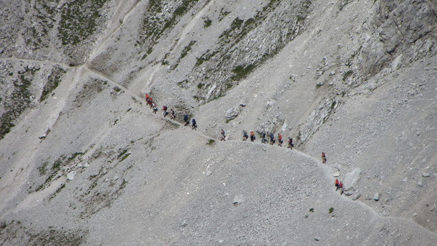 High angle view of people hiking on mountain