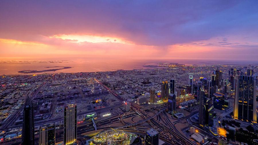 Illuminated Cityscape At Twilight