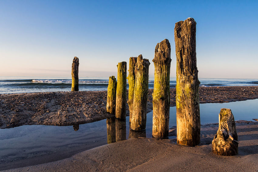 Groynes on shore of the Baltic Sea. Baltic Sea Beach Clouds And Sky Coast Day Groyne Kuehlungborn Kühlungsborn Landscape Nature Nature No People Ocean Outdoors Sea Shore Sky Sky And Clouds Water Waves