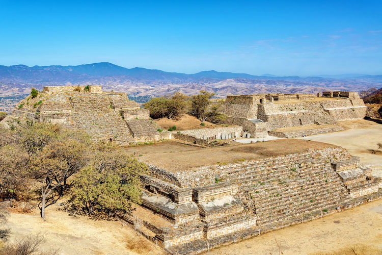 Temples in the ancient city of Monte Alban in Oaxaca, Mexico Ancient Archeology Architecture Cityscape Hills Mayan Mayan Ruins Mexico Oaxaca Oaxaca México  Pyramid Ruins Temples Travel Civilization Culture Maya Monte Alban Mountain Platform Ruin Stone Stones Temple Tourism