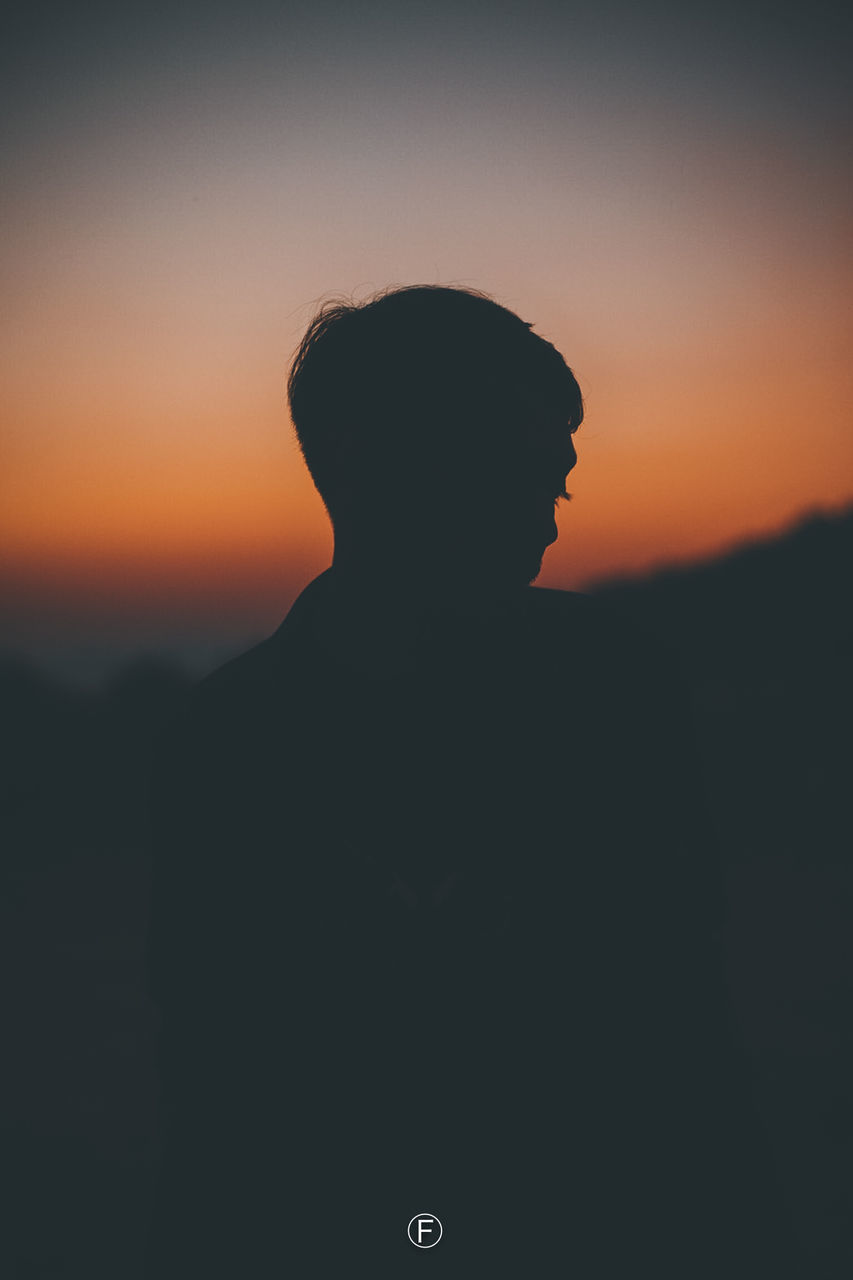 sunset, silhouette, sky, men, one person, real people, orange color, lifestyles, standing, portrait, leisure activity, nature, headshot, waist up, beauty in nature, males, scenics - nature, outdoors, adult, teenager