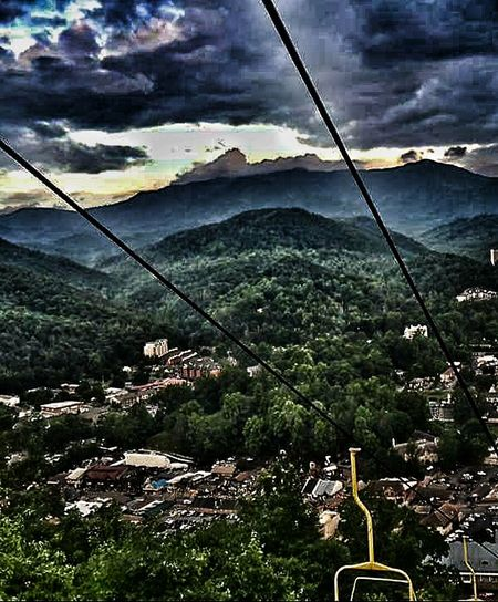 Landscape Light And Shadow Dsrk Clouds Mountains Valley Fog In For Ground Sky Lift Little Town Valley Village Little Houses Below Dramatic Sky Light To Dark Finding Balance Fog In The Background Tree-lined Mountain Yellow Sky Lift The Great Outdoors - 2016 EyeEm Awards Smokey Mountains, Tennessee, Usa