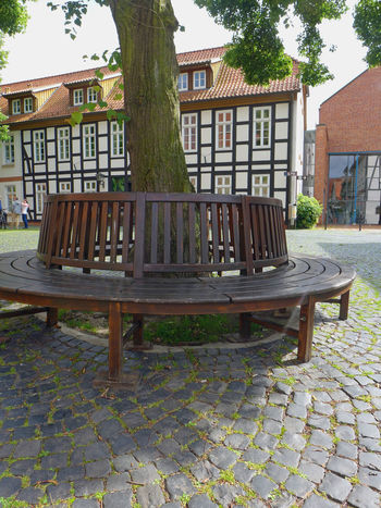 Absence Architecture Bench Bouldering Building Exterior Built Structure Cobblestone Empty Façade Front Or Back Yard Just Around The Corner KopfSteinPflaster No People Streetphotography Tree Walking Around The City  Wooden Bench