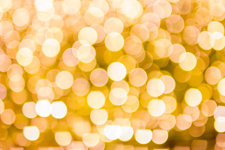 Illuminated Christmas Defocused Backgrounds Glowing Celebration Holiday Decoration Circle Geometric Shape Shiny Bright No People Lighting Equipment Vibrant Color Light - Natural Phenomenon Shape Pattern Christmas Lights Abstract Yellow Brightly Lit Light Textured Effect