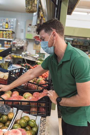 Full length of man holding fruits at market
