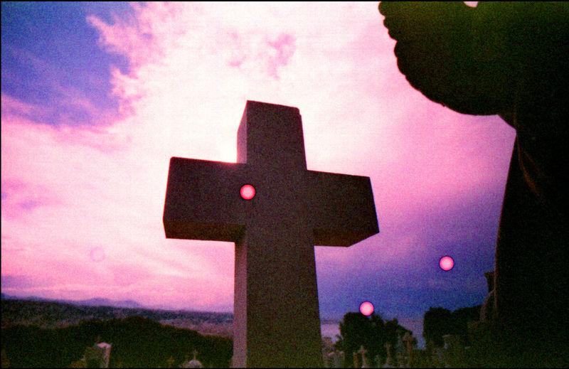 Cross sign against sky during sunset