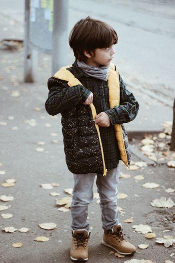 Full length of cute boy standing on street