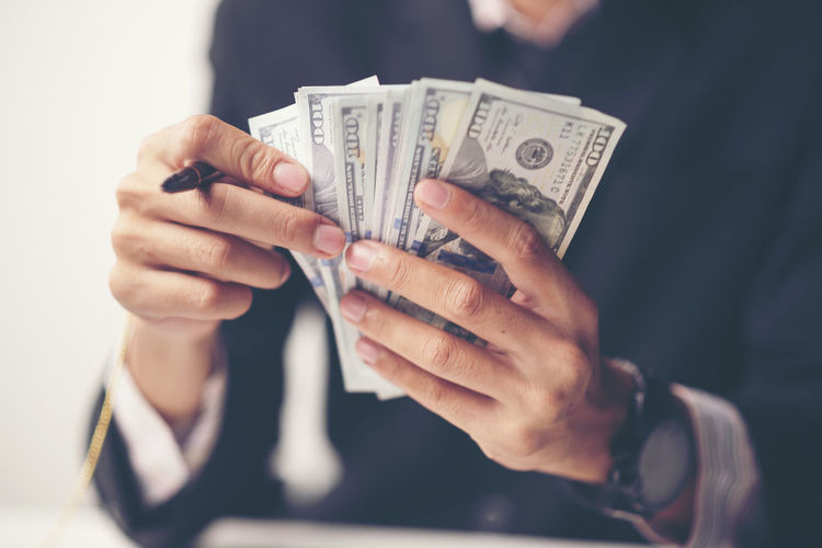 Adult Business Close-up Currency Finance Finger Front View Hand Holding Human Body Part Human Hand Indoors  Lifestyles Men Midsection Paper Currency People Real People Savings Wealth