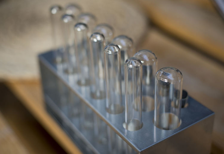Close-up of test tubes in rack on table