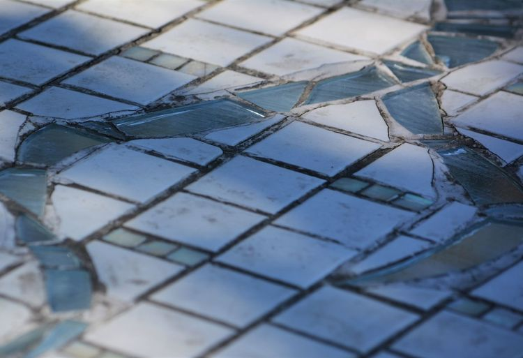 High Angle View Of Glass Artwork On Ground