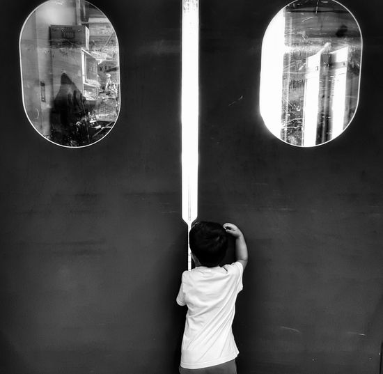 The OO Mission Blackandwhite Photography Little Boy Curiosity Blackandwhite Door Windows From Where I Stand Malephotographerofthemonth My Son Exploring New Ground Curious Black&white Kids Being Kids Shapes And Forms Round Shape