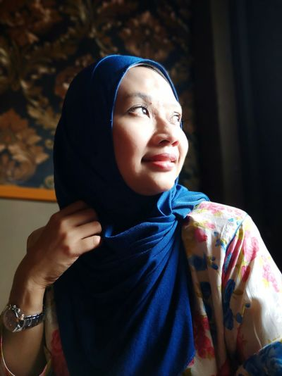 Close-Up Of Thoughtful Woman Wearing Hijab At Home