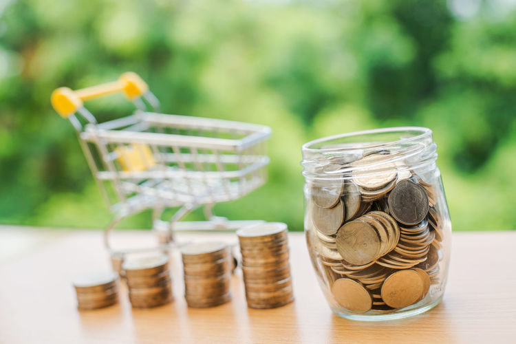Business Close-up Coin Container Day Economy Finance Focus On Foreground Food Food And Drink Glass - Material Jar Large Group Of Objects No People Outdoors Savings Selective Focus Still Life Table Transparent Wealth