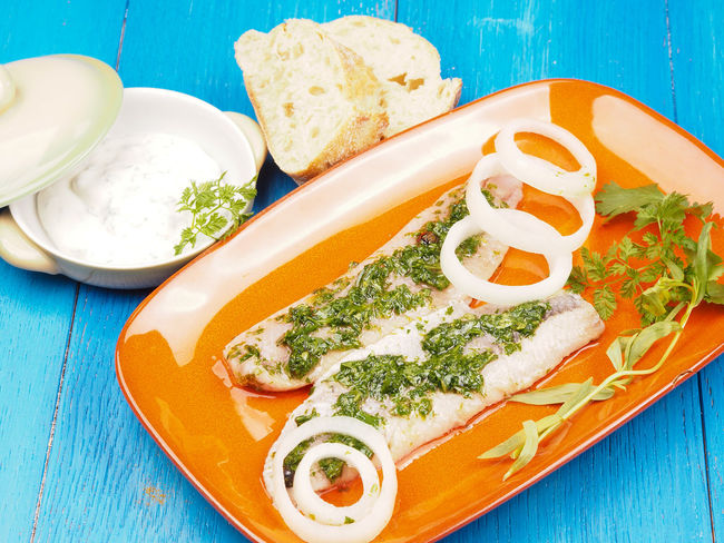 Tasty herring with marinade on a blue restaurant table Baguette Filet Herring Plant Seafood Blue Table Bread Close-up Day Delicious Food Food And Drink Freshness Healthy Eating Indoors  Marinade No People Onions Plate Protein Ready-to-eat Restaurant SLICE Table Tasty