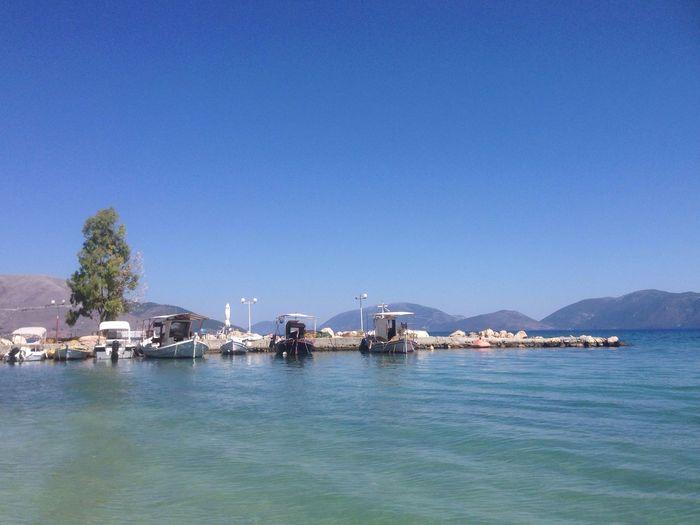 Boats on sea in greece