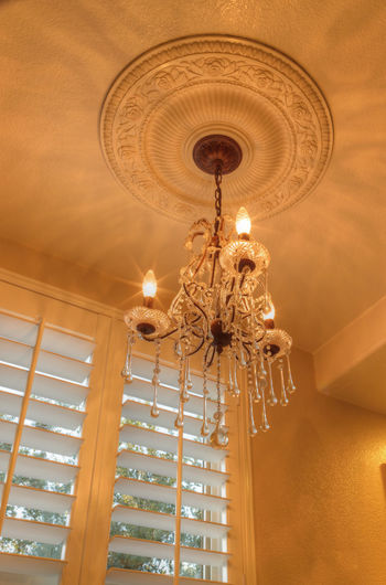 Marble bathroom with feng shui decor and chandelier. Architecture Ceiling Chandelier Chandelier Light Crown Molding Day Hanging Home Interior Illuminated Indoors  Lighting Equipment Low Angle View Luxury No People Plantation Shutters Vertical