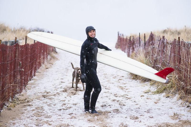 Full length portrait of woman on snow land