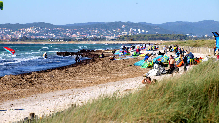 Beach Sea Mountain Large Group Of People Sand Water Sky Outdoors Day Vacations Landscape Nautical Vessel Sports Race Hyères Les Palmiers Aquatic Sport Le Var Healthy Lifestyle Surfing Extreme Sports Multi Colored