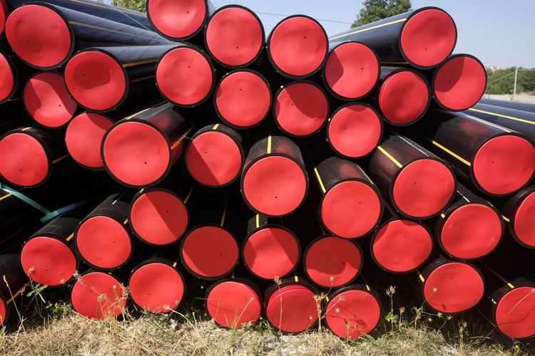 Stacked tubes on field