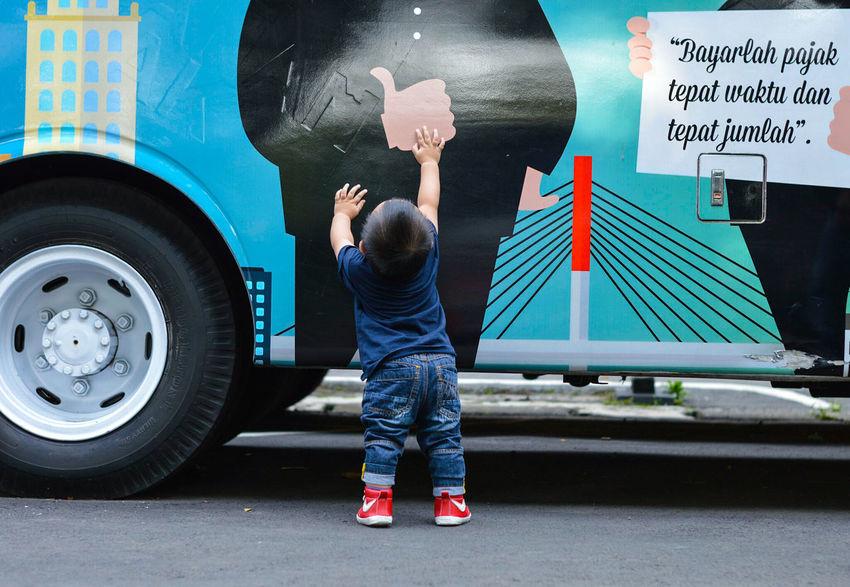 Baby behind the bus... Baby Babyboy Bus Standing Blue Colorful Urban Day Outdoors Transportation 14months EyeEm Best Shots EyeEmNewHere EyeEm Gallery EyeEmBestPics EyeEm Selects