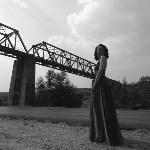 Railroad Bridge In Background Smiling Outdoors Railroad Track One Woman Only Monochromatic