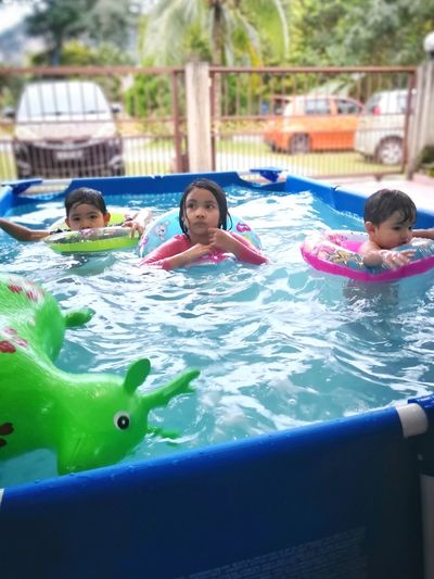 EyeEm Selects Water Slide Water Friendship Swimming Child Swimming Pool Childhood Togetherness Males  Smiling Inflatable Ring Floating On Water Floating Inflatable
