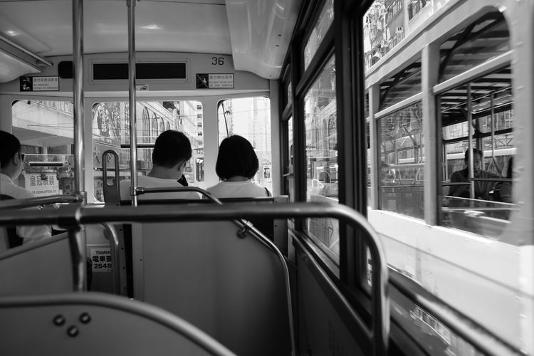 Tram Blackandwhite Boys Childhood Day Friendship FujifilmX70 Indoors  Leisure Activity Lifestyles Love Men Mode Of Transport People Public Transportation Real People Rear View Sitting Togetherness Transportation Two People Vehicle Seat Women