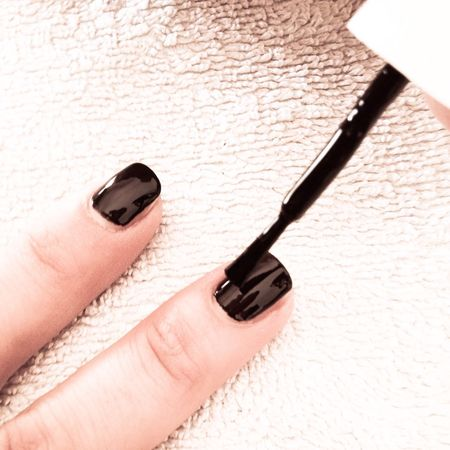 Woman nails polish in black Beauty Black Color Brush Close Up Close-up Coloring Cosmetics Fingernails Glamour Human Body Part Human Finger Indoors  Manicure Nail Nails Painting Part Of Person Polish Skin Treatment