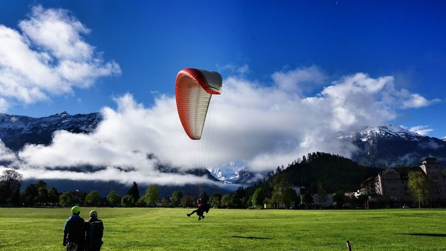 Morning Glory Amazing Place Beauty In Nature Interlaken Clouds And Sky Travel Destinations Bernese Oberland Alps Switzerland Switzerland Cloud Formations Means Of Transportation Flying Paragliding Mountain Range Cityscapes