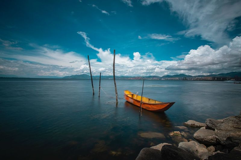 boat in the river Nautical Vessel Water Transportation Mode Of Transportation Sky Cloud - Sky Sea Scenics - Nature Beauty In Nature Tranquility Tranquil Scene Nature Moored No People Day Blue Reflection Idyllic Beach Sailboat