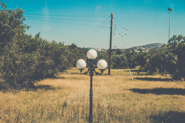 Plant Field Grass Land Sky Nature Landscape Day No People Tree Electricity  Environment Cable Technology Growth Sunlight Tranquil Scene Connection Tranquility Outdoors Power Supply Eyeem Travel Summertime Blue Sky Vintage Style