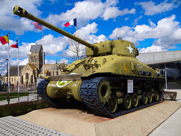 Allied Fla Allied Invasion Architecture Blue Skies Blue Skies + Clouds Cloud - Sky D-Day D-Day History D-Day Muse Day Flag Flags No People Normandy Outdoors Sherman Sherman Tank Sky St Mere L'Eglise WWII History WWII Normandy