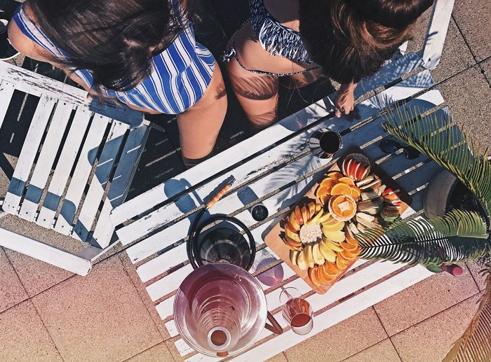 High angle view of women with fruits