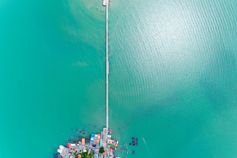 Aerial view of fishing boats moored at harbor