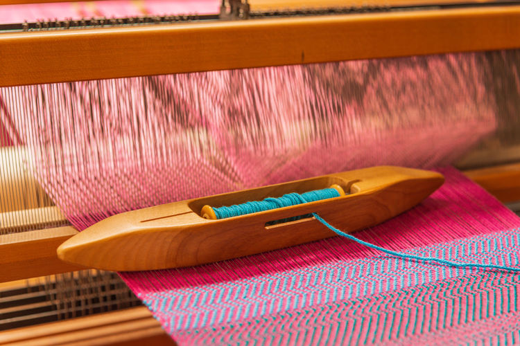High angle view of thread on weaving machinery