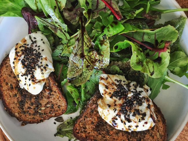 Poached eggs on toast with green salad Eggs On Toast Poached Eggs  Salad Side Salad Food Food And Drink Freshness Ready-to-eat High Angle View No People Plate Healthy Eating Vegetable