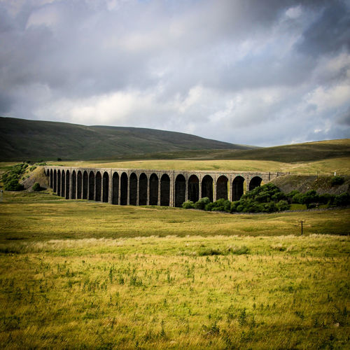 Architecture Beauty In Nature Built Structure Cultures Day Grass History Landscape Nature No People Outdoors Ribbleheadviaduct Scenics Sky Tree Viaduct War