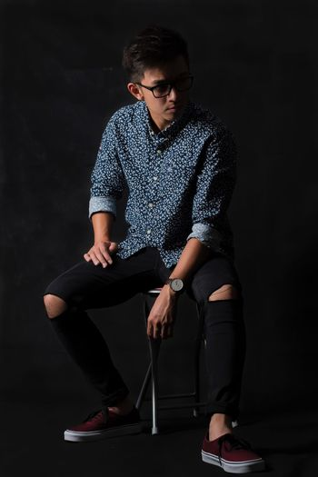 Vietnamese Asian  EyEmNewHere Danielwellington EyeEm Selects One Person Fashion Young Adult Eyeglasses  Sitting Front View Casual Clothing Studio Shot Fashion Model Black Background Lifestyles Beauty EyeEmNewHere