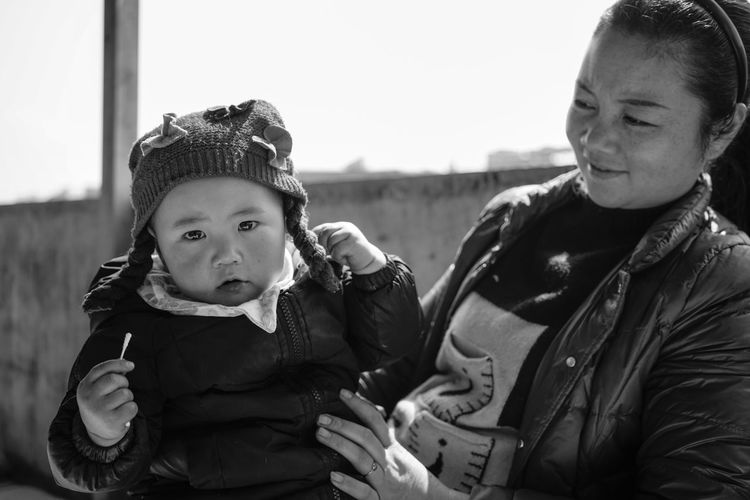 Babyhood Childhood Close-up Cute Elementary Age Family Focus On Foreground Front View Girls Happiness Leisure Activity Lifestyles Looking At Camera Portrait Real People Togetherness Two People Warm Clothing The Portraitist - 2018 EyeEm Awards