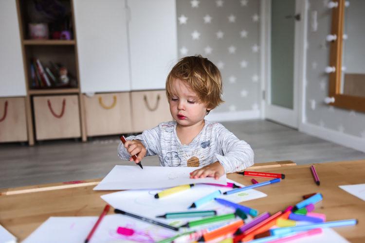 Boy looking at book at home
