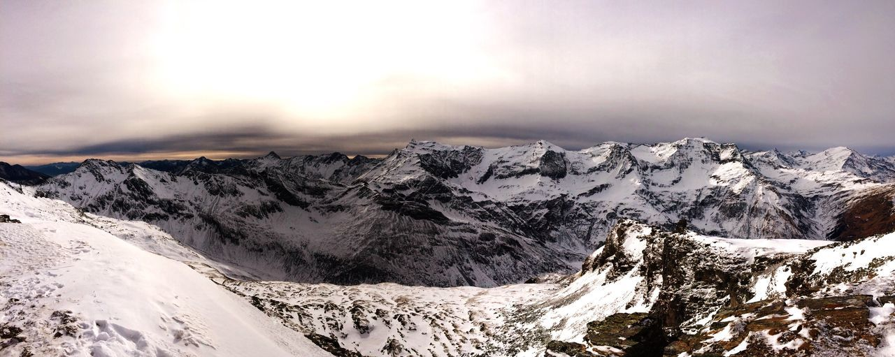 Panoramic View Of Snow Covered Mountains Against Sky