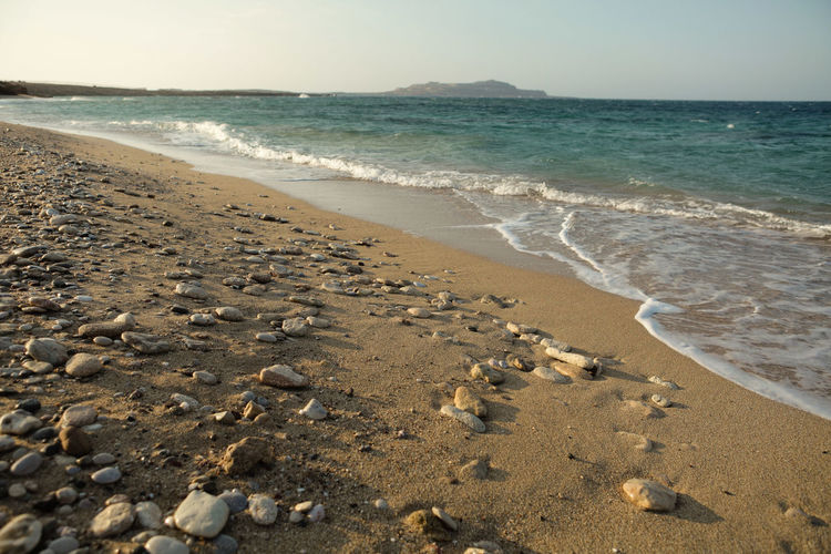 Sea Water Beach Land Sand Motion Wave Horizon Horizon Over Water Beauty In Nature Scenics - Nature Sky Nature Sport Tranquility Tranquil Scene Outdoors Pebbles Foam