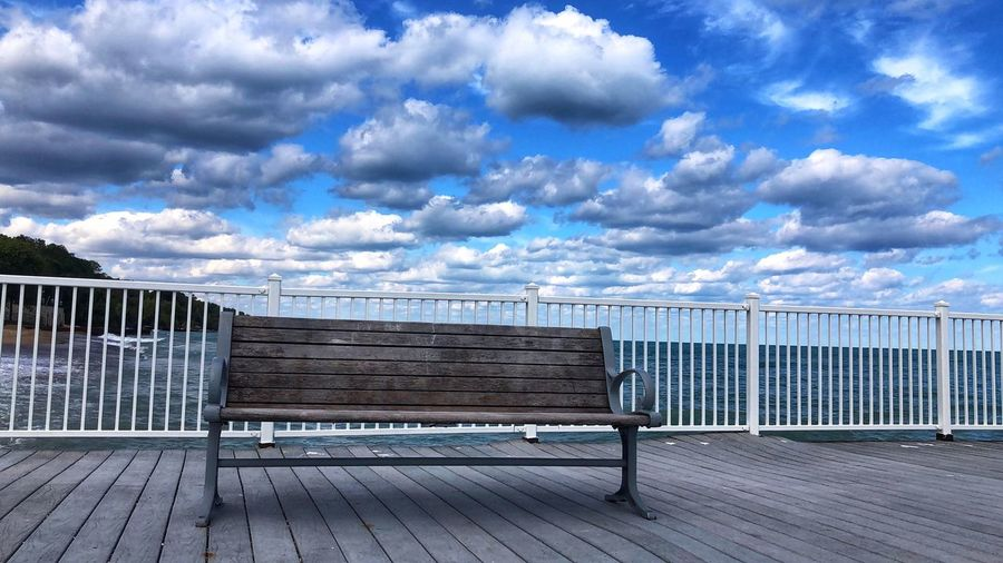 Bench with a view Cloud - Sky Sky Barrier Fence Day Boundary Nature No People Railing Tranquility Seat Bench Beauty In Nature Tranquil Scene Outdoors Scenics - Nature Empty Protection Security