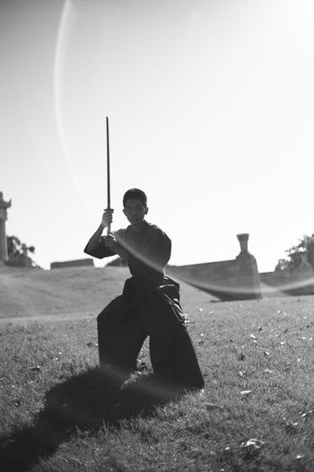 The modern samurai. Clear Sky Day Field Full Length Holding Men Nature One Man Only One Person Outdoors People Real People Sky Sport Standing Weapon Young Adult